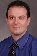 Dr. Lascarides