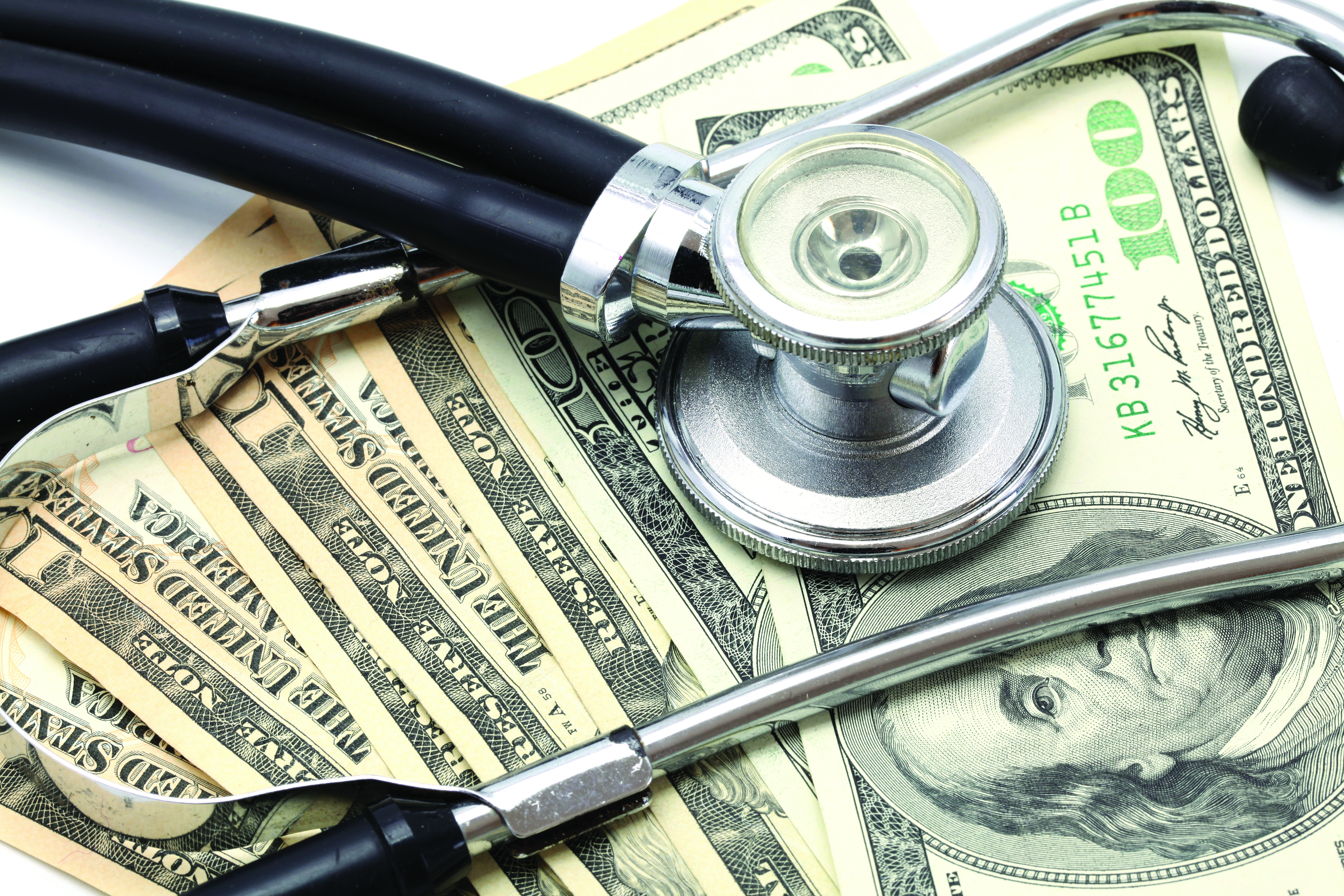 bigstock-stethoscope-on-money-dollar
